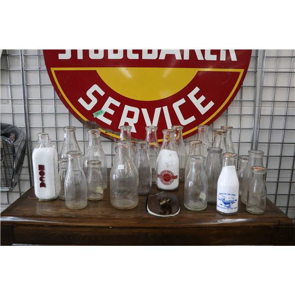 Large selection of Canadian made and collectible milk bottles including labelled United Dairies Ltd.