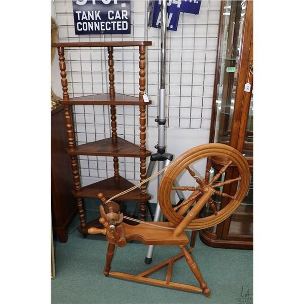 Five tier corner shelving unit and a wooden spinning wheel