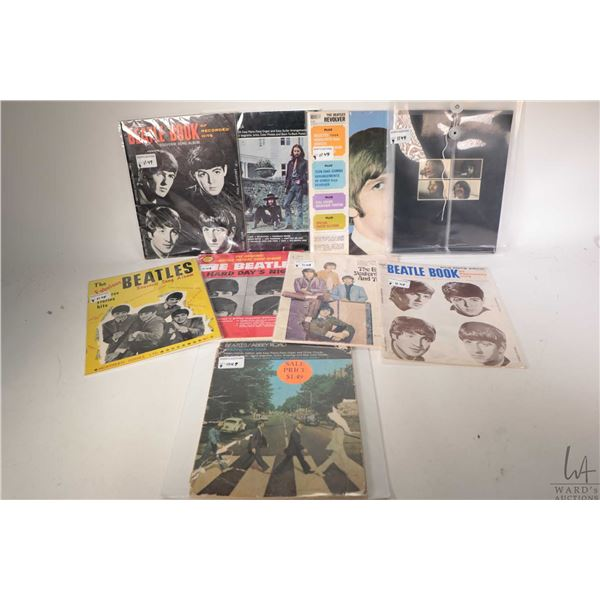 """Nine copies of vintage Beatles sheet music including """"Can't Buy Me Love"""", """"From Me to You"""", """"I Want"""