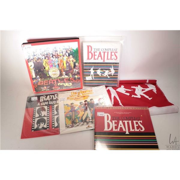 Selection of re-issue Beatles LPs including Sgt. Peppers Lonely Hearts Club band complete with book