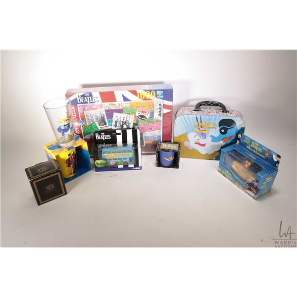 """Selection of Beatles collectible merchandise including """"Yellow Submarine"""" Corgi bus and submarine, c"""
