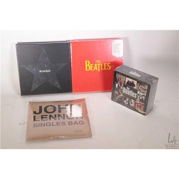 """Selection of Beatles factory sealed merchandise including five CD set """" The Interviews"""", John Lennon"""