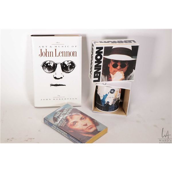 Selection of Beatles merchandise including Lennon and McCartney books and a Lennon CD set and coffee