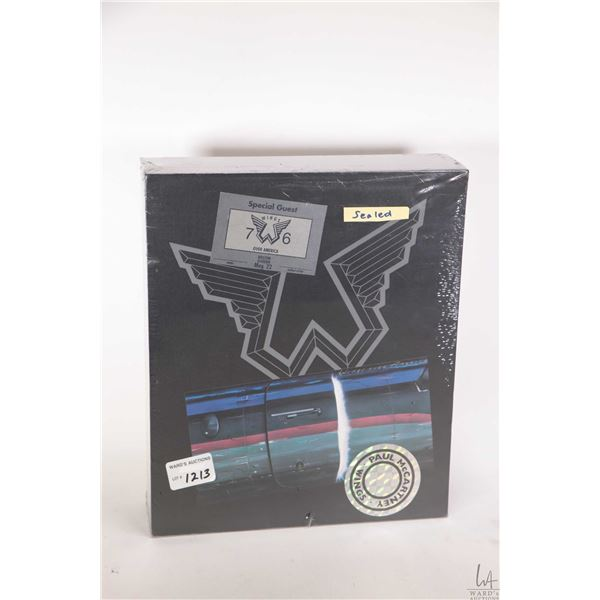 """Factory sealed Paul Mc Cartney/Wings """"Wings Over America"""" deluxe edition containing disc, DVD, book"""