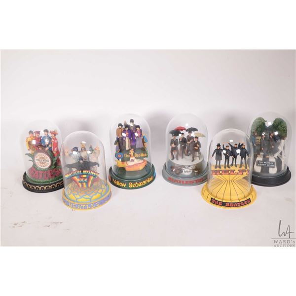 """Six collectible Beatles Franklin Mint figures under glass domes including ?Help"""" and """"Yellow Submari"""