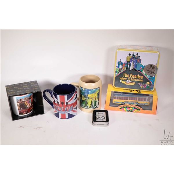 """Selection of Beatles collectible merchandise including """"Yellow Submarine"""" puzzle, Hornby die cast """"M"""