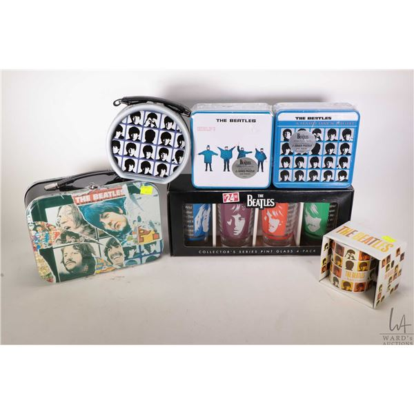 Selection of Beatles collectible merchandise including two lunch boxes, two 300 piece puzzles, four