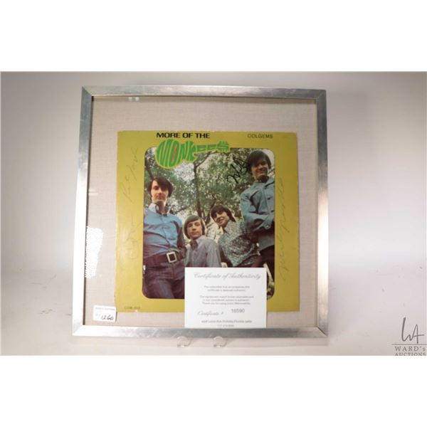 """Framed copy of """"More of the Monkees"""" with hand signed ink signatures and COA issued from Iconz Memor"""