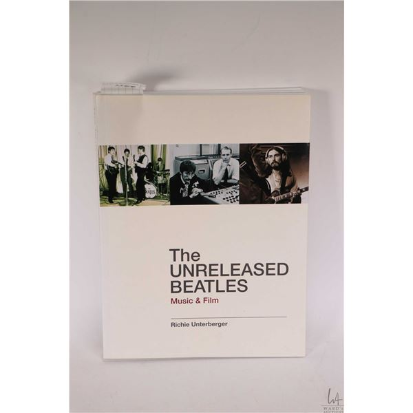 """Beatles collectible soft cover book """"The Unreleased Beatles- Music and Film"""""""