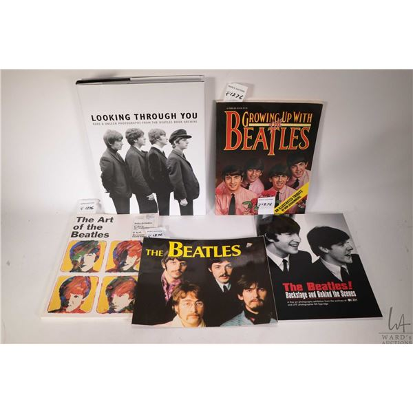 """Five Beatles collectible books including four soft cover and a hardcover pictorial book """"Looking Thr"""