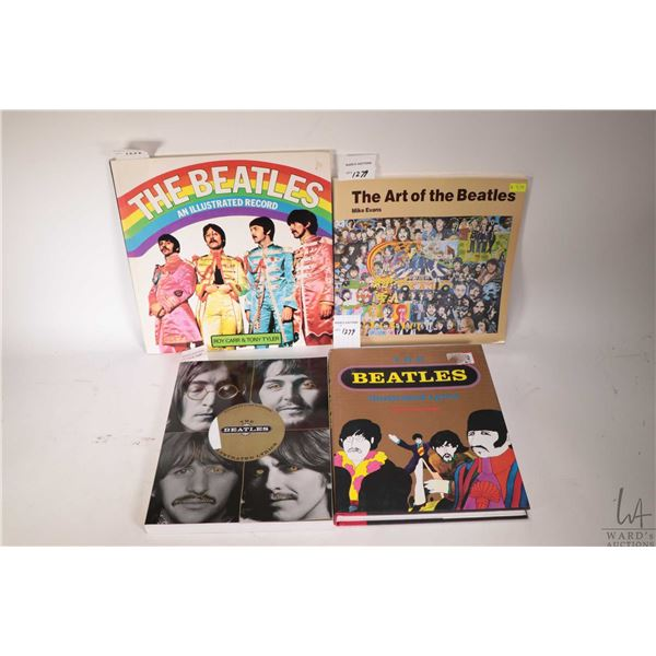 Four Beatles reference books including three soft cover and hardcover ?The Beatles Illustrated Lyric