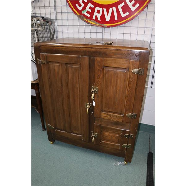 Antique three door ice box, original interior has been removed and repurposed as storage cabinet, or