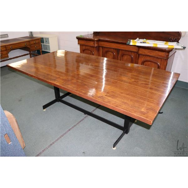 """Appears to be shop made 43"""" X 84"""" board room table with laminated mahogany plank top and metal base"""