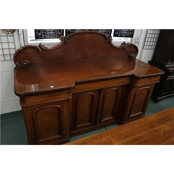 """Victorian mahogany sideboard with multiple drawers and doors and backboard with carved scroll, 78"""" w"""