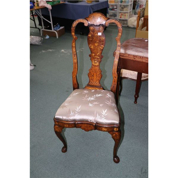 Antique Dutch marquetry chair, heavily inlaid on all forward and side facing surfaces and satin dama