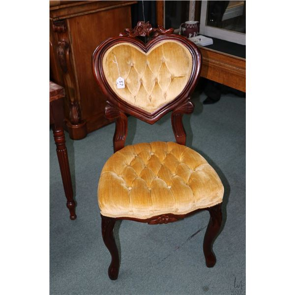 Victorian style mid 20th century parlour chair with button tufted heart shaped back and carved flora