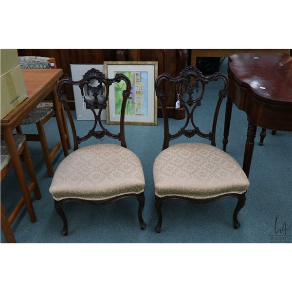 Pair of antique slipper chairs with beautifully carved backs and other highlights, with cabriole sup
