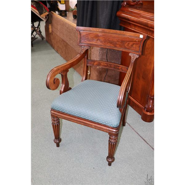 Antique William IV flame mahogany carver with reeded supports, scroll arms and upholstered seat