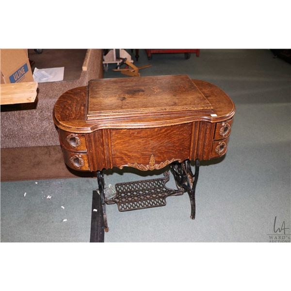 Antique oak cased Eldredge treadle sewing machine, with gilded name cast into base