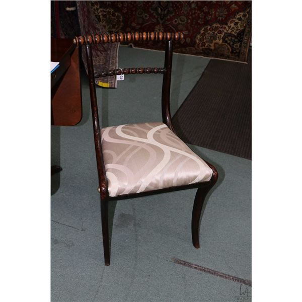 Pair of antique side chairs with curved bobbin turned back supports and upholstered seats