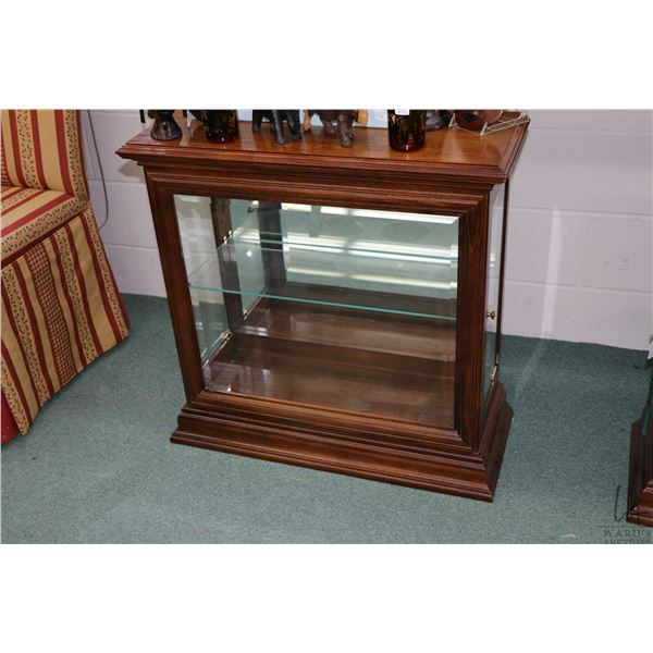 """Modern low design illuminated display cabinet with single glass shelf and bevelled front panel, 29"""""""