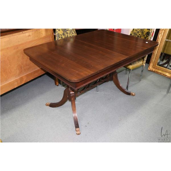 Mid 20th century Regency style dining table with brass capped feet