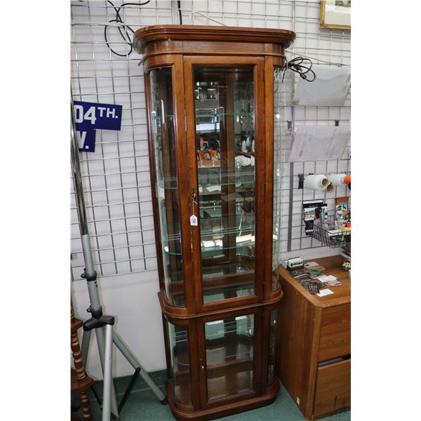 Semi contemporary two door, oak framed illumintated display cabinet with curved glass and glass shel