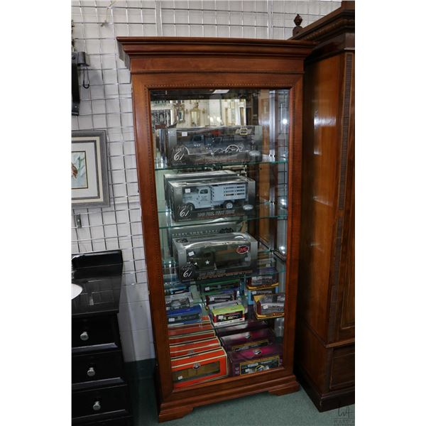 Semi contemporary illuminated display cabinet with bevelled front panel and two glass doors on each