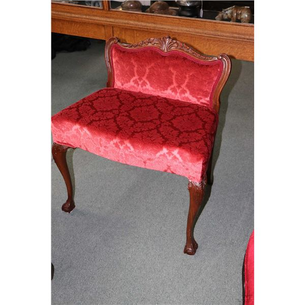 Antique low back vanity bench with carved ball and claw front supports and red velvet brocade fabric