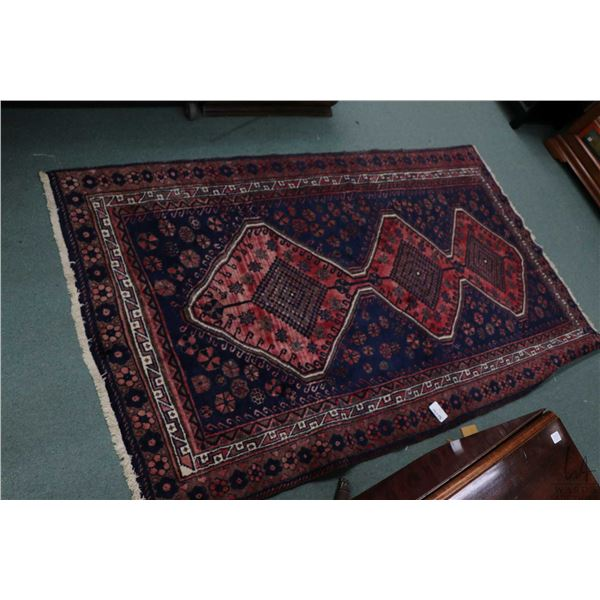 100% Iranian Baloch wool area carpet with triple medallion, red and blue background, multiple border