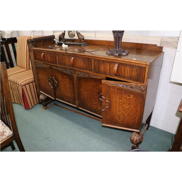 Antique quarter cut oak sideboard with original key and pull, three drawers and four doors, bulbous