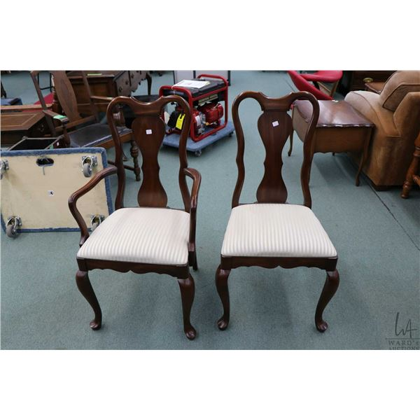 Eight cherry dining chairs including six side chairs and two carvers made by Gibbard