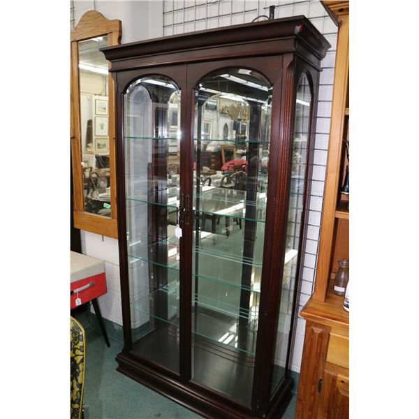 Solid mahogany illuminated two door display cabinet with four adjustable glass shelves and bevelled