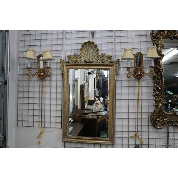 """Semi contemporary shell motif gilt framed wall mirror, overall dimension 49"""" X 29"""" plus a pair of do"""