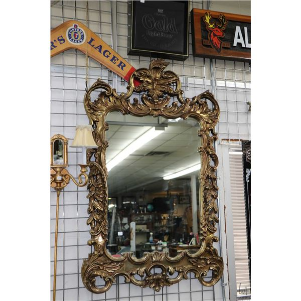 """Baroque style semi contemporary gilded mirror overall dimensions 56"""" X 34"""". Note: Not Available For"""