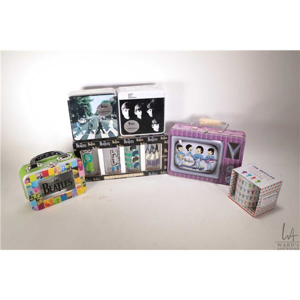 Selection of Beatles collectible merchandise including two lunch boxes, two puzzles, coffee cup and