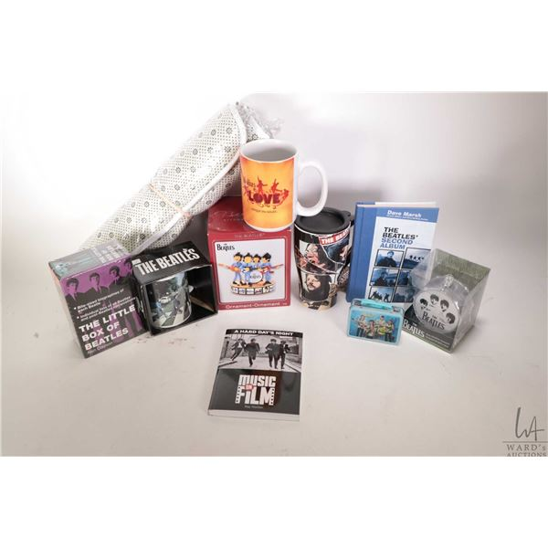 Selection of Beatles collectible merchandise including Christmas ornaments, four volume pocket book