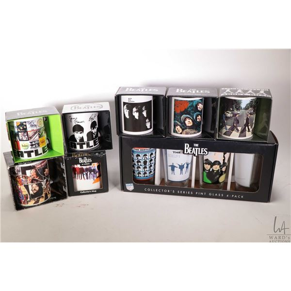 Seven Beatles coffee cups and a four piece pint glass set, all factory packaged