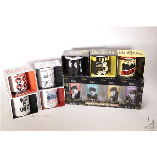 Seven Beatles coffee cups and a four piece pint glass set, all factory packages