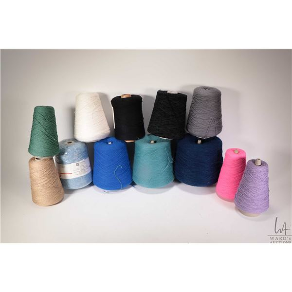 Selection of hand knitting and knitting machine yarn including full or near  cones of Knitmaster var