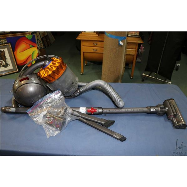 Dyson canister vacuum cleaner with attachments including beater head, crevice tools etc. Working wel