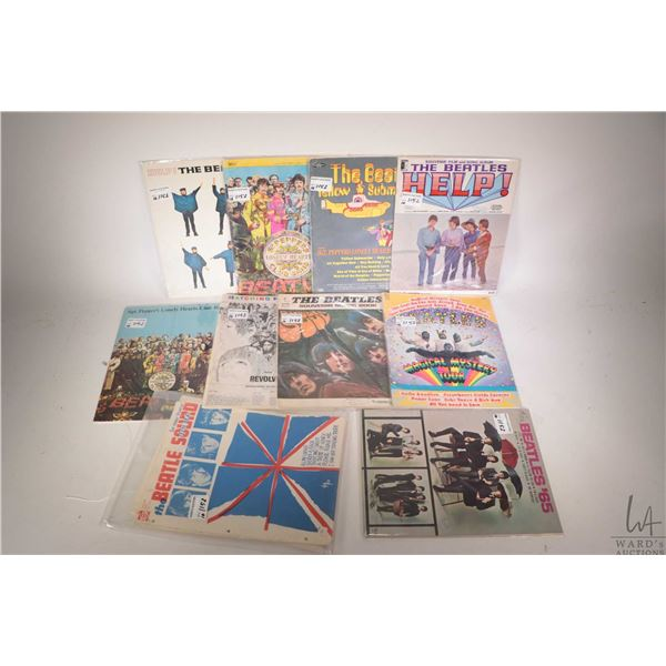 Ten Beatles song books including Yellow Submarine, Sgt. Peppers etc.