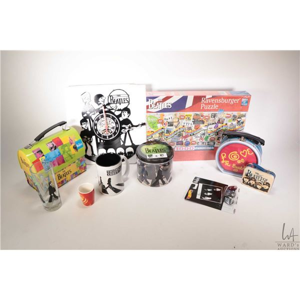 Selection of Beatles collectibles including sealed 1000 pce. puzzle, wall clock, lunch pails etc.
