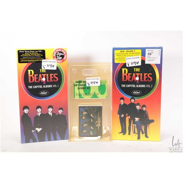 Factory sealed Beatles CD sets Vol. 1 & 2 and a large sealed trading card set