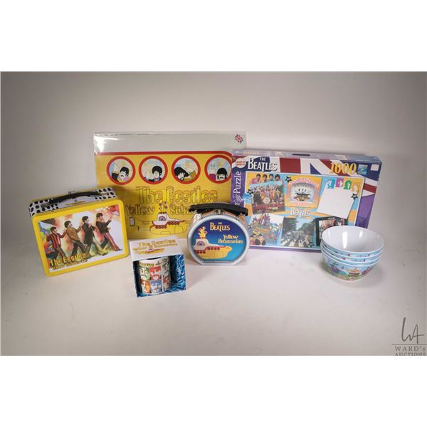 Selection of Beatles collectibles including two lunch boxes, factory sealed 1000 pce. puzzle, Yellow