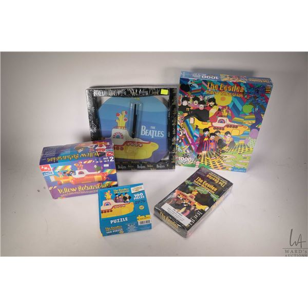 Selection of Beatles Yellow Submarine Yellow Submarine wall clock, collectibles including 1000 pc. p