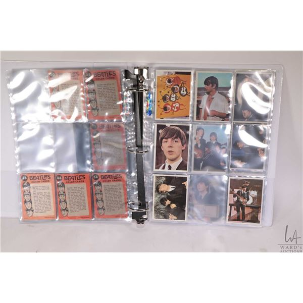 Three ring binder with a selection of coloured Beatles collector cards