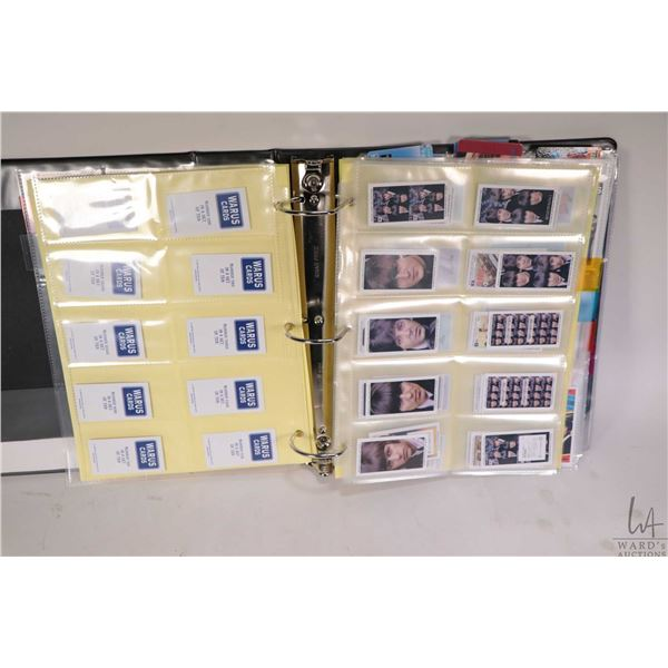 Three ring binder with large selection of Beatles collector cards, cigar bands, faux driver's licens