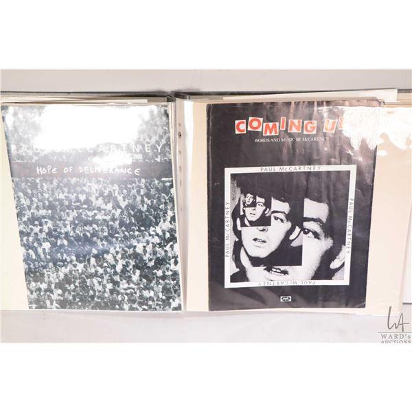 Folio of approximately three Paul McCartney sheet musics