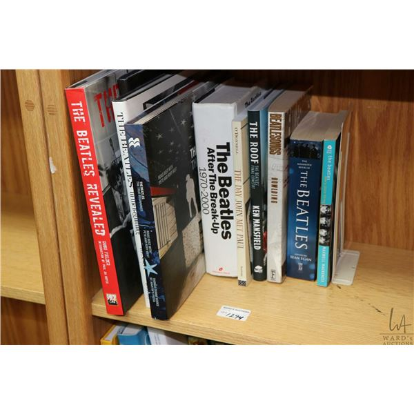 """Selection of Beatles and Beatles related books including """"The Beatles Revealed"""" by Hugh Felder, """"The"""